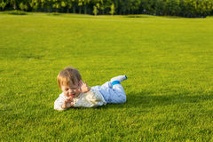 Little baby on the glade. Stock Photo