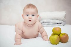 Little baby with green apples royalty free stock photography