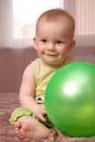 Little baby with green ball Stock Photo
