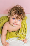 Little baby in a green towel after bathing. Royalty Free Stock Image