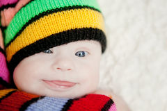 Little baby in hat gnome with Downs syndrome. Little baby girl in hat gnome with Downs syndrome Stock Photography