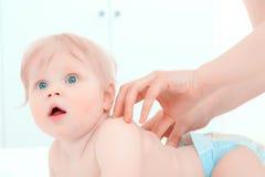 Little baby having a massage Stock Photos