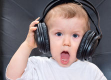 Little baby with headphones Royalty Free Stock Image