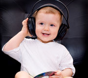 Little baby with headphones Royalty Free Stock Photo