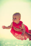 Little baby held by mother sunny day. Royalty Free Stock Images
