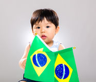 Little baby holding barzil flag Royalty Free Stock Images