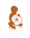 Little baby holding a clock. Black silhouette of a little baby seated holding a clock Royalty Free Stock Photography
