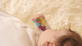 Baby and holding toy. Little baby and holding toy stock video footage