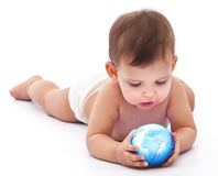 Little baby holds small globe in her hands. Royalty Free Stock Photo