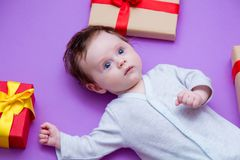 Little baby with holiday gifts Royalty Free Stock Photos