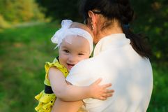 Little baby is hugging mother stock image