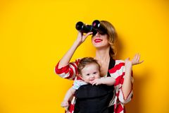 Little Baby In Carrier And Mother With Binoculars Royalty Free Stock Image