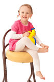 Little Baby Is Sitting On Yellow Chair Royalty Free Stock Image