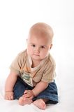 Little baby in jeans. Sitting on the floor Stock Photo