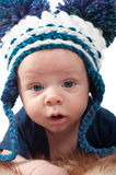 Little baby in knitted hat Stock Image
