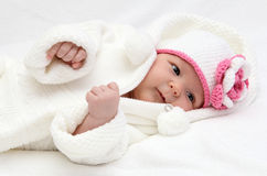 Little baby in knitted white hat Stock Photo