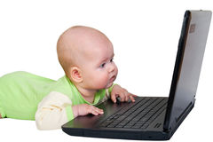 Little baby with laptop Royalty Free Stock Photo