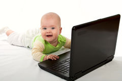 Little baby with laptop. Stock Photo
