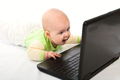 Little baby with laptop. Royalty Free Stock Photography