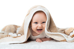 Little baby is laughing under the  carpet Stock Photography