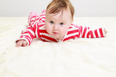 Little baby learning to crawl Stock Photos