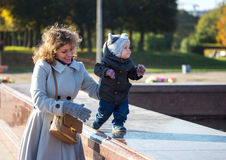 Little baby learning to step. With the help of his mother Royalty Free Stock Photo