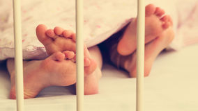 Little baby legs under the blanket. Royalty Free Stock Photos