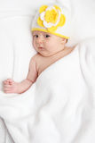 A little baby lies in bed Royalty Free Stock Photo