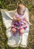 Little baby lies on a diaper-tender on the grass Stock Photos