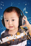 Little baby listening to music Stock Photo