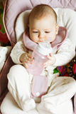Little baby looking at the bottle Royalty Free Stock Photo