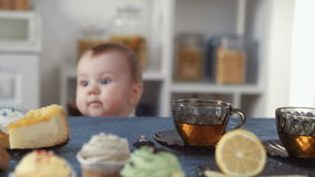 Little baby looking at sweets stock video footage