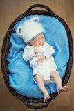 Little baby lying in a basket. Stock Photo