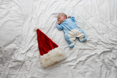 Little baby lying on bed Stock Images