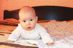 Little baby lying on the bed Stock Photo