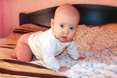 Little baby lying on the bed Royalty Free Stock Image