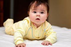Little baby lying on the bed Royalty Free Stock Photos