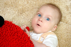 Little baby lying on the carpet Royalty Free Stock Image