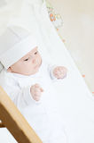 Little baby lying in crib Stock Photos