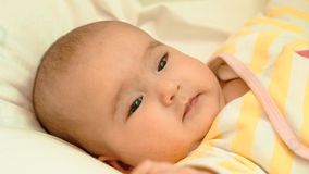Little baby lying in his bed close-up portrait Royalty Free Stock Photography