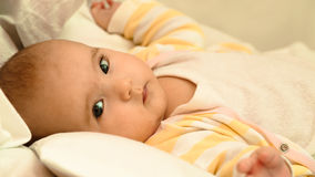 Little baby lying in his bed close-up portrait. Little newborn baby lying in his bed close-up portrait Royalty Free Stock Photo
