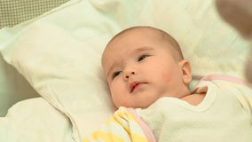 Little baby lying in his bed close-up portrait. Little newborn baby lying in his bed close-up portrait Stock Photo