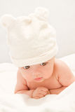 Little baby lying on the white blanket Stock Photo