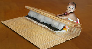 Baby making Giant Sushi Royalty Free Stock Photos