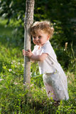 Little baby in the midle of green nature Royalty Free Stock Photo