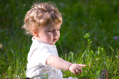 Little baby in the midle of green nature Royalty Free Stock Image