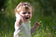 Little baby in the midle of green nature Stock Photos