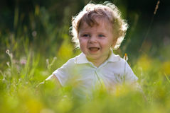 Little baby in the midle of green nature Royalty Free Stock Images