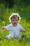 Little baby in the midle of green nature Royalty Free Stock Photography