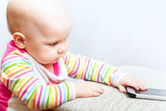 Little baby with mobile phone Stock Photo